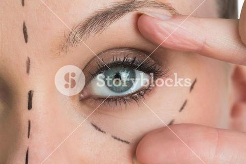 Woman opening the green eye with her hand