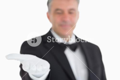 Waiter showing his opened hand