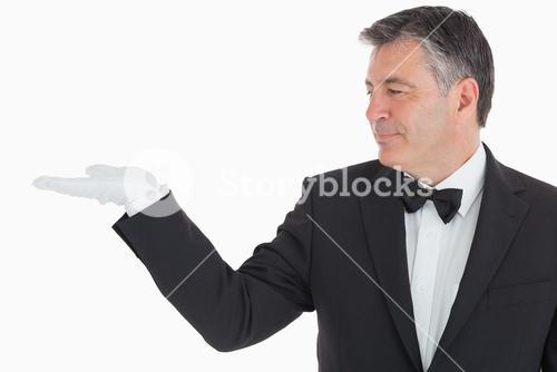 Waiter showing us his opened hand