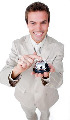 Smiling businessman is using a bell