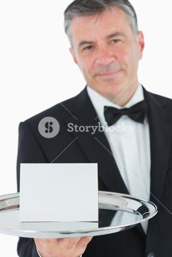 Waiter holding tray with paper