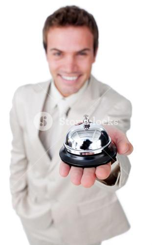Charming businessman is using a bell