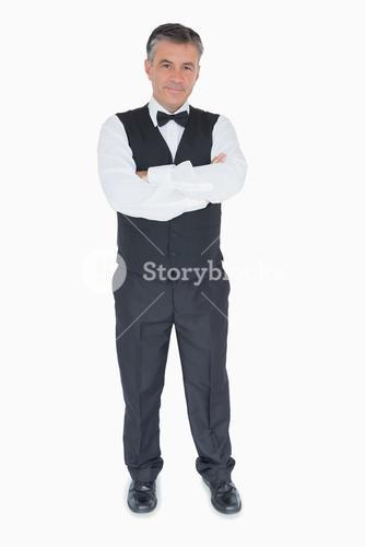 Waiter with crossed arms