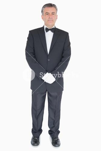 Waiter standing with crossed arms
