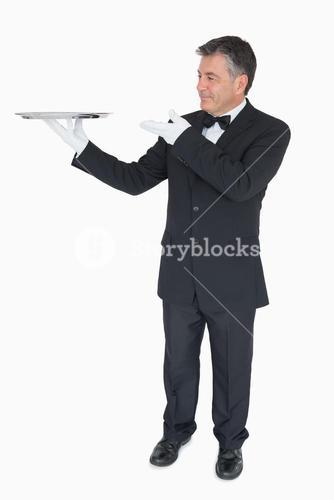 Waiter presenting empty tray