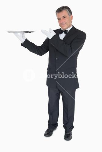 Happy waiter presenting a tray