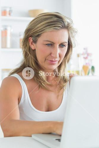 Content woman using laptop