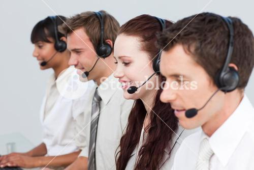 Manager working with his team in a call center