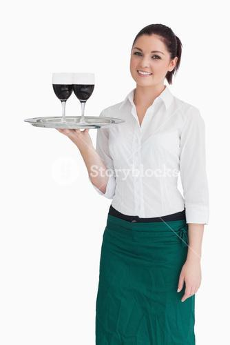 Woman holding tray with glasses of wine