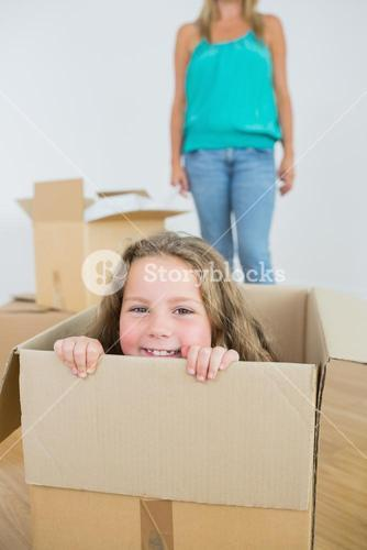 Laughing girl in moving box