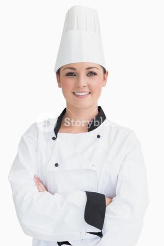 Smiling cook wearing a chef hat