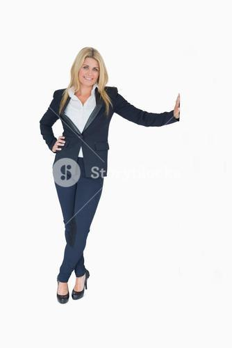 Businesswoman leaning on wall