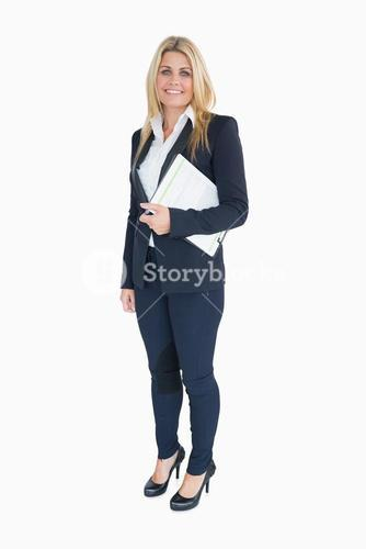 Businesswoman posing with a clipboard