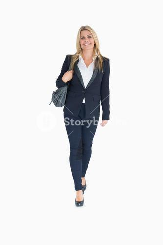 Smiling business woman walking