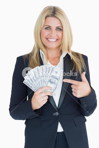 Happy Welldressed woman holding dollars