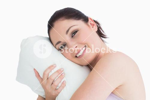 Woman waking up on her pillow