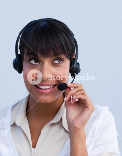 Attractive businesswoman working in a call center