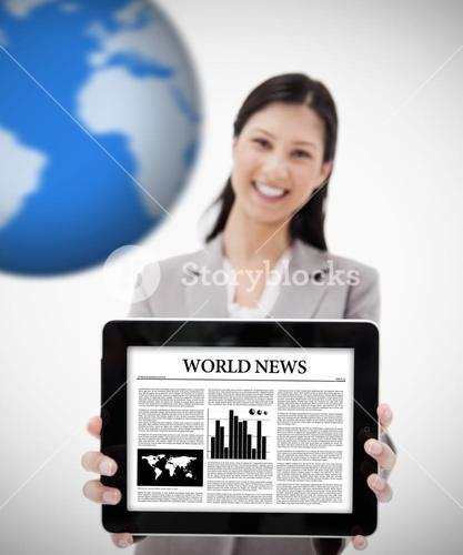 Businesswoman holding digital tablet showing world news
