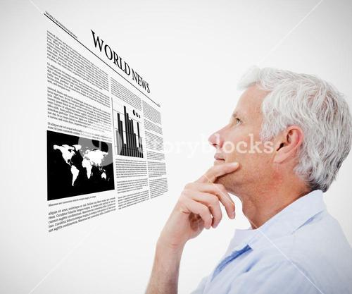 Man reading holographic world news