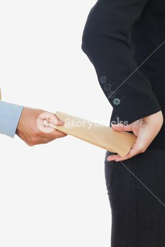 Hand giving bribe to business woman