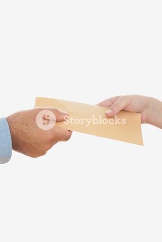 Business people holding envelope