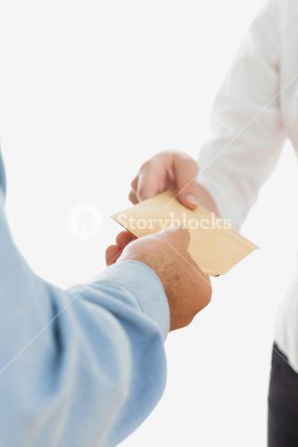 Businessman handing over bribe to coworker