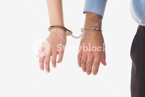 Businesspeople handcuffed together
