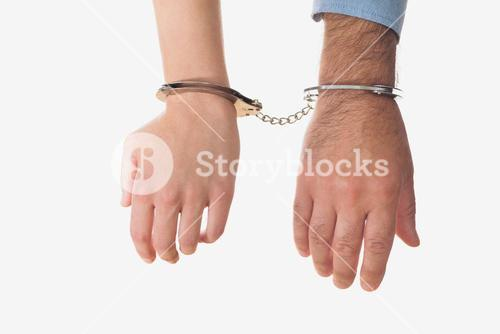 Hands of business people in handcuffs