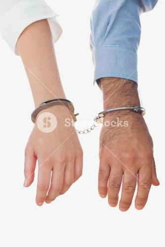 Closeup of handcuffed business people
