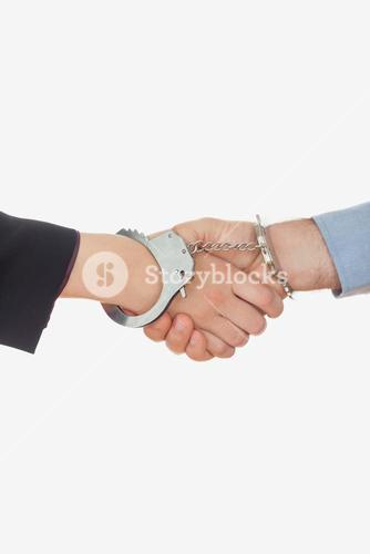 Closeup of handcuffed handshake
