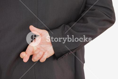Businessman with fingers crossed