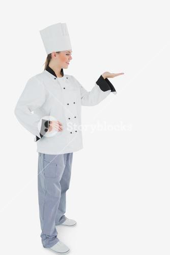 Female chef looking at invisible product