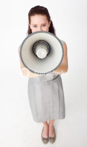 High angle of a businesswoman shouting through a megaphone