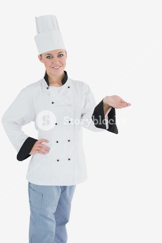 Female chef with hand on waist holding invisible product
