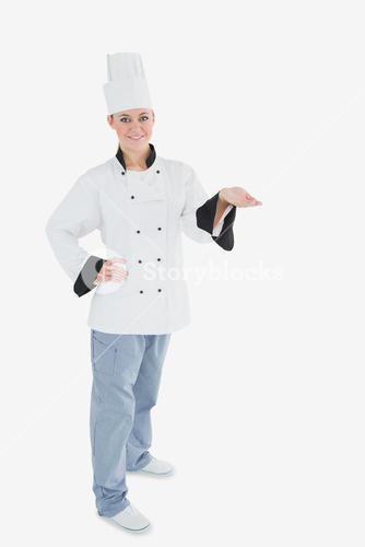 Portrait of female chef holding invisible product