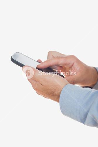 Hands using mobile phone