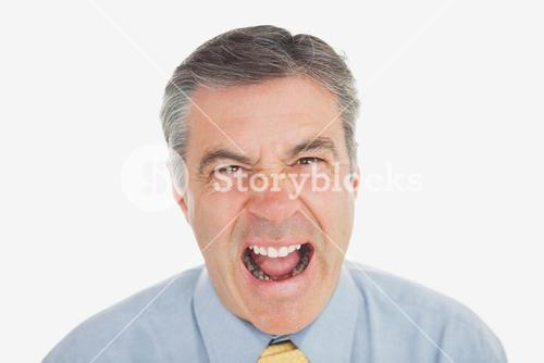 Mature businessman shouting