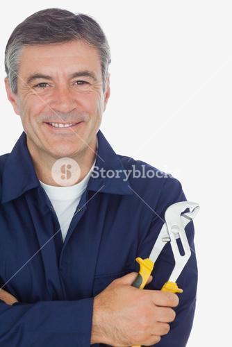 Mechanic with arms crossed holding pliers