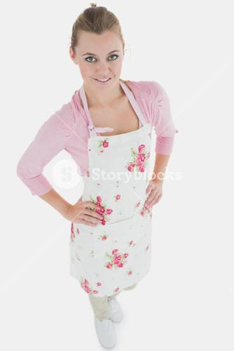 Young maid with hands on waist