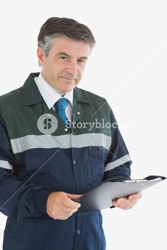 Mature repairman holding clipboard