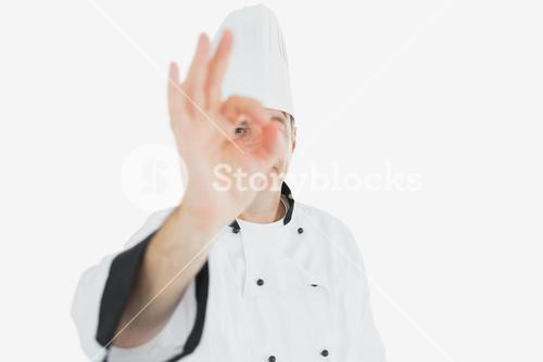 Mature chef showing ok sign