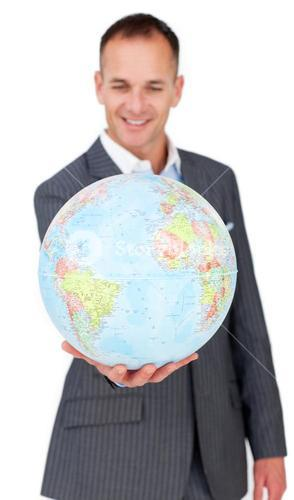 Selfassured businessman smiling at global business expansion
