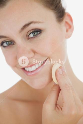 Closeup of woman applying makeup