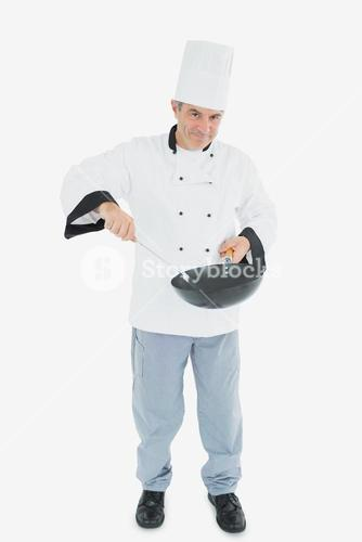 Confident chef cooking food