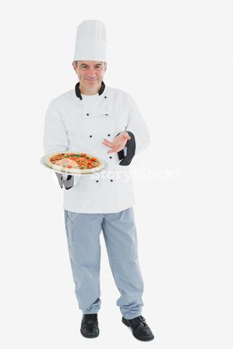 Happy male chef displaying pizza