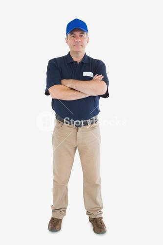 Confident delivery man with arms crossed