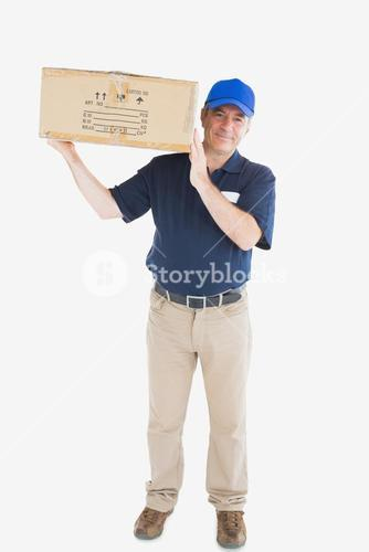 Mature courier man carrying cardboard box