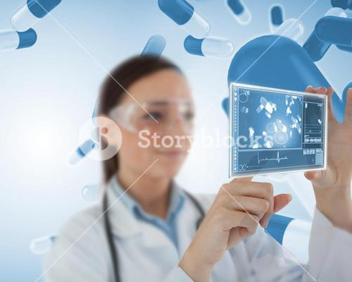 Smiling nurse holding virtual screen