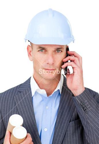 Serious male architect on phone