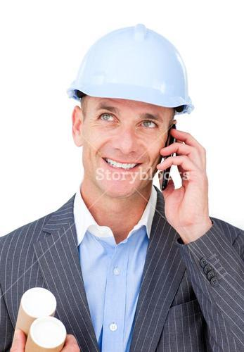 Cheerful male architect talking on phone